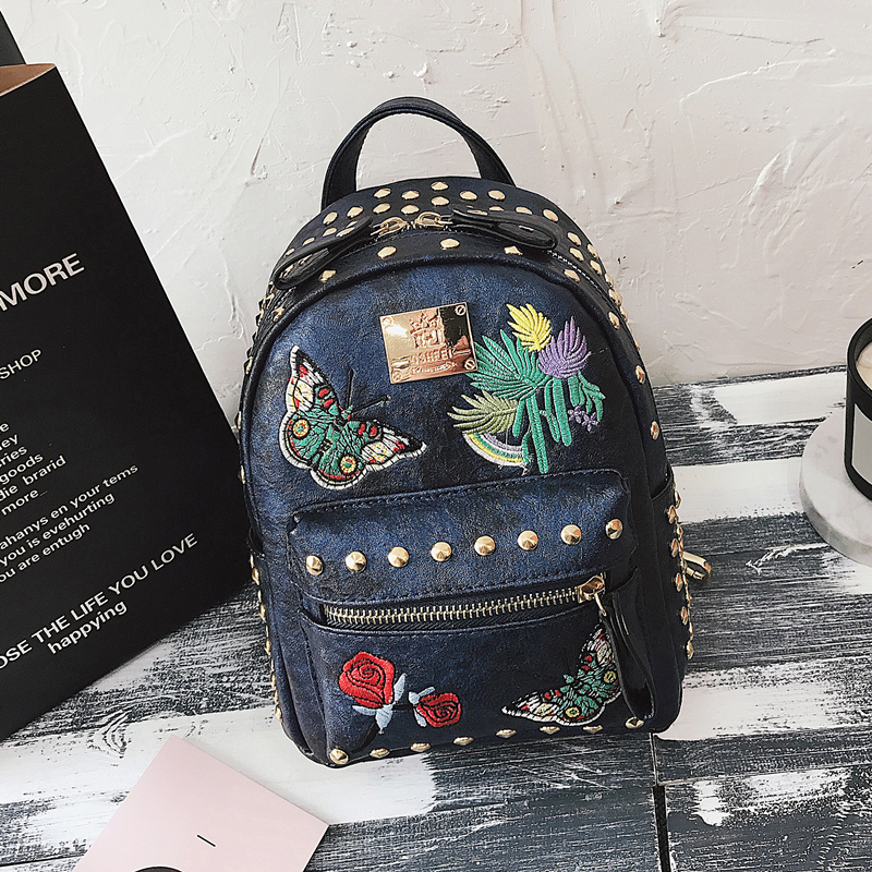 Korean version of the tide 2018 new retro embroidery rivets backpack casual wild multi-purpose small bag 29