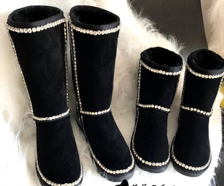 Nouvelle station européenne de luxe à la main vent en cuir tube haut tube bottes de neige femme coton chaussures cousu à la main perceuse simple noir