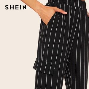 Image 4 - SHEIN Slant Pocket Verticale Gestreepte Broek Vrouwen Lente Toevallige Elastische Taille Broek Zwart Regelmatige Mid Taille Streetwear Broek
