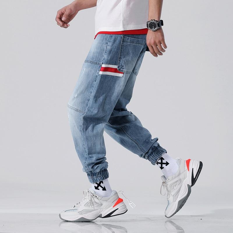 Large Size Fashion Streetwear Men Jeans Blue Color Loose Spliced Slack Bottom Harem Pants Patch Stripe Hip Hop Joggers Jeans Men