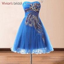 Blue peacock cocktail dress