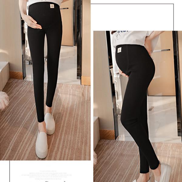 3102 # a través de V cintura baja vientre maternidad Legging primavera otoño moda ropa de punto para mujeres embarazadas pantalones delgados de embarazo
