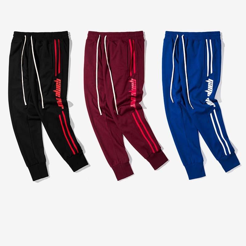 Aolamegs Mens casual pants spliced color side stripes men track pants street fashion vintage sweatpants drawstring jogger pants