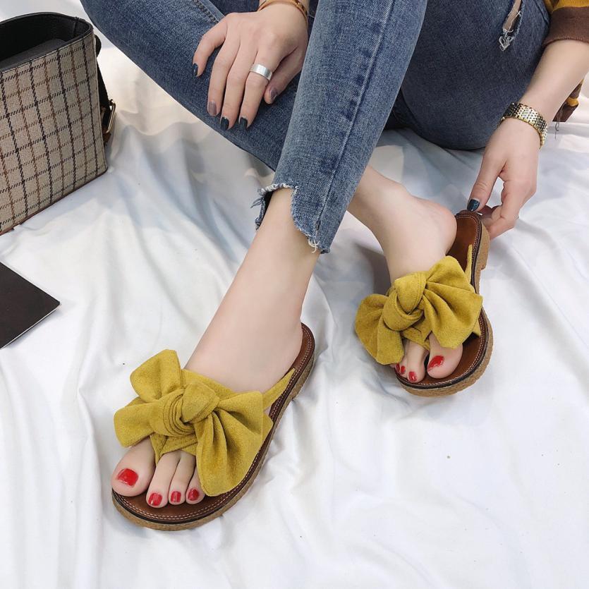 Été offre spéciale femmes tongs mode solide couleur noeud papillon plat talon sandales taille 36-40 extérieur pantoufle chaussures de plage pour femme