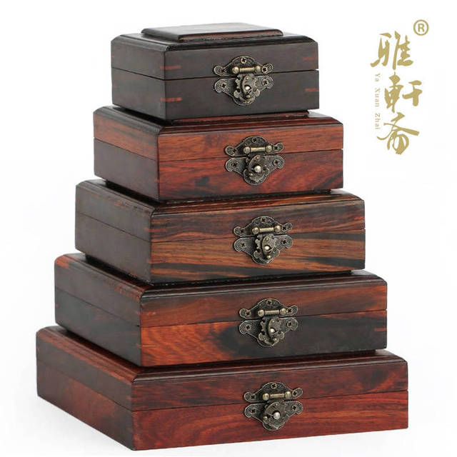 A Grenadilla wood jade jewelry box containing a set of five rosewood