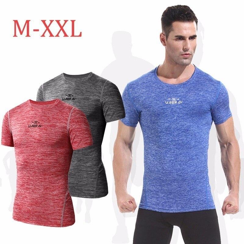 940d2bdd76 2018 Compressão Camisa de Manga Curta Sólida Execução Camisetas Homens da  Aptidão do Verão de Secagem Rápida Masculino Musculação Crossfit Tops M-2XL