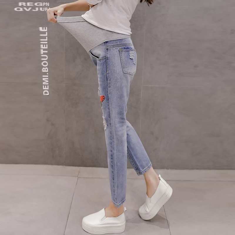 Broken hole stomach lift maternity dress autumn and winter new fashion jeans embroidered butterfly maternity pants