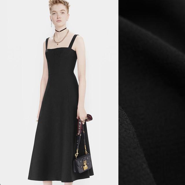 Zwart jurkje 140