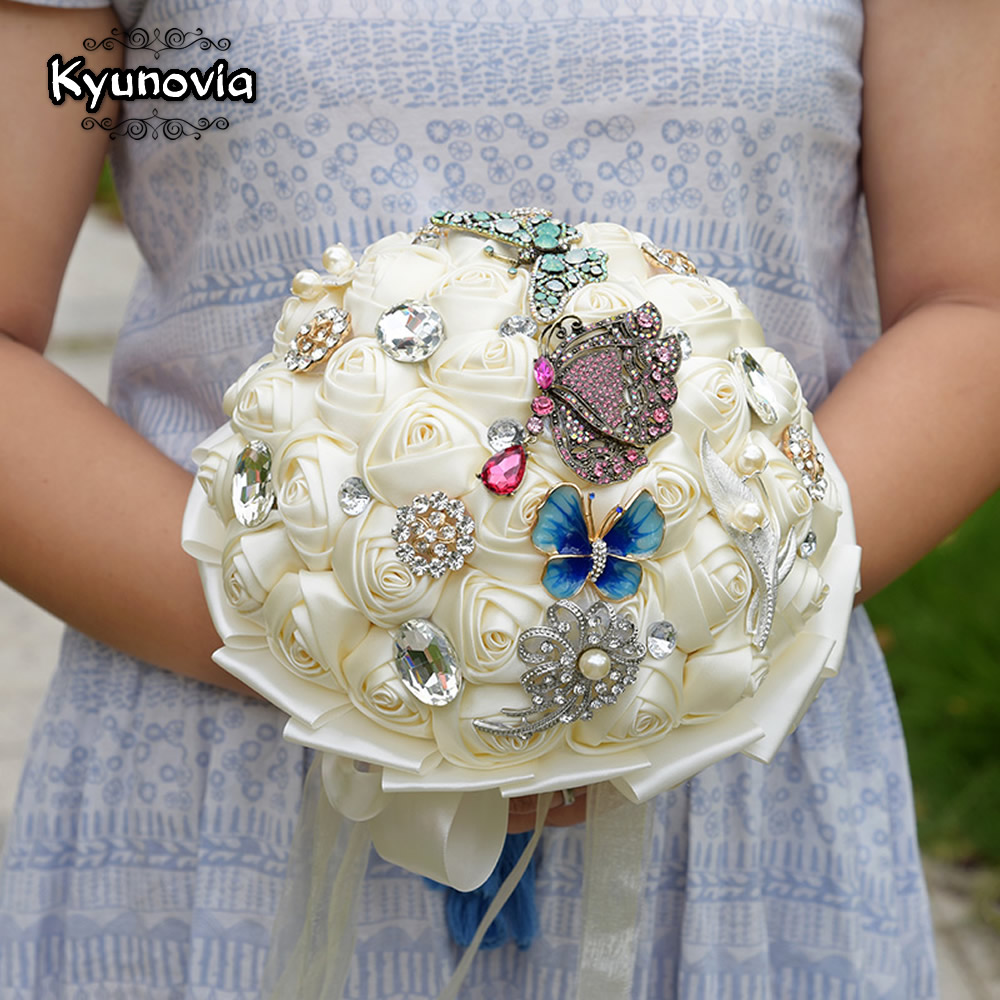 Kyunovia butterfly brooches bridal bouquet artifical wedding flowers kyunovia butterfly brooches bridal bouquet artifical wedding flowers with rhinestones pearl and silk roses wedding bouquet fe34 in wedding bouquets from izmirmasajfo