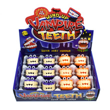 Novelty Wind-up Toy Cute Vampire Ghosts Tooth with Eyes Walking Babbling Teeth Clockwork Toys Halloween Gift Whoelsale halloween chain clockwork toy ghost frankenstein vampire capsule funny joke prank wind up jumping walking toys kid gifts jm305