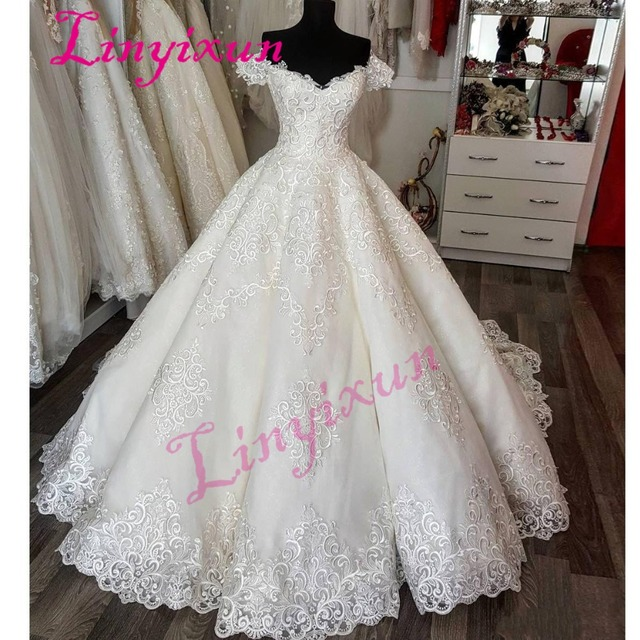 Elegant Short Sleeves Wedding Dress With Appliques Sweetheart Tulle Long Wedding  Gowns 2018 Custom Made Glamorous Bridal Dresses 12a1031ce324