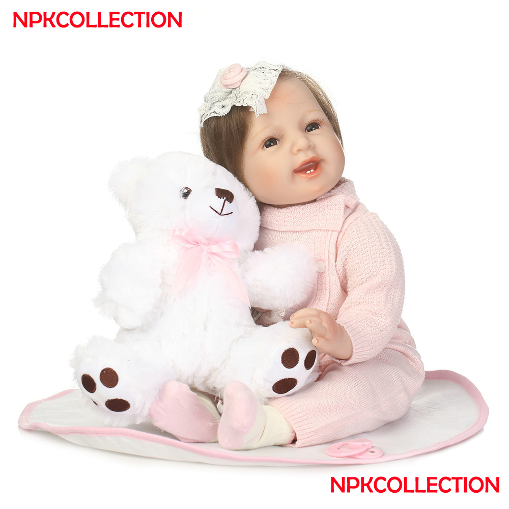 Soft silicone reobrn baby dolls NPK 22inch Bebes reborn dolls pink sweater real born girl princess for child gift bonecas rebornSoft silicone reobrn baby dolls NPK 22inch Bebes reborn dolls pink sweater real born girl princess for child gift bonecas reborn