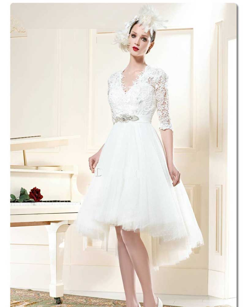 whitney port wedding dress hi low wedding dress Jim Hjelm sheer A line wedding with netting and 3 D flower details from