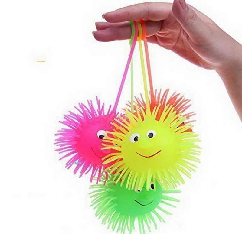 12pcs lot Flash Puffer Ball Hedgehog Ball Vent with Charged Random Color Kids Toys Novelty and