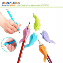 Фотография Dolphin fish Wobi child children pencil Wobi students hold a pen writing posture correction with