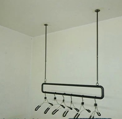 wrought iron wall clothing rack on the clothing store shelves, condole  carries on the