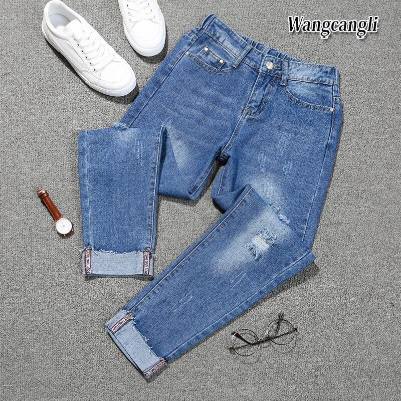 HTB1tpLYbNuTBuNkHFNRq6A9qpXaK Fashion Large size women's denim nine pants 2018 spring and summer high waist hole 5XL Blue women's elastic feet pants 015#