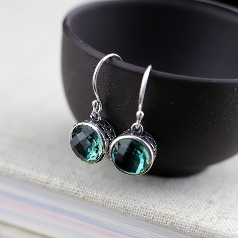все цены на Jewelry, Thai Silver Hand Earrings Wholesale S925 Sterling Silver Jewelry, Hollow Lady, Cut Green Crystal Eardrop.