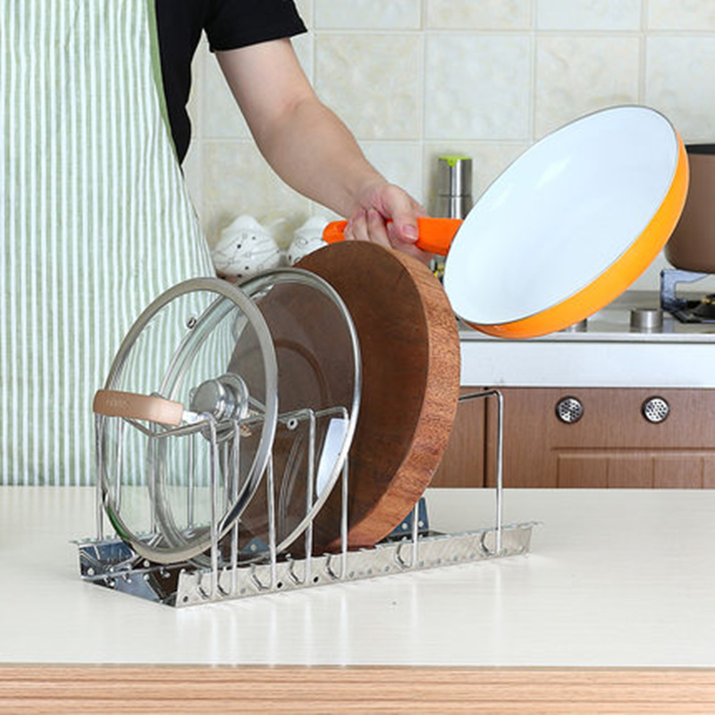 ' ' from the web at 'https://ae01.alicdn.com/kf/HTB1trAJNXXXXXcBXVXXq6xXFXXXJ/Foldable-Stainless-steel-pot-lids-holder-Pot-Pan-Cover-Lid-skillet-stand-holder-rack-chopping-board.jpg'