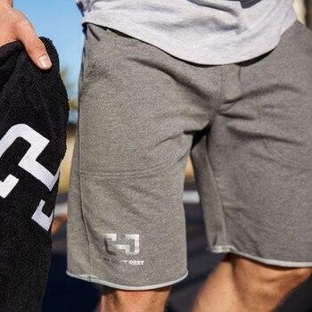 ¡Nueva marca de 2019! pantalones cortos para correr, pantalones cortos deportivos con bolsillo para hombre