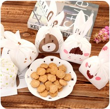 100pcs/lot Cute rabbit ear cookie bags Self-adhesive Plastic Bags for Biscuits Snack Baking Package food bag party Supplies(China (Mainland))