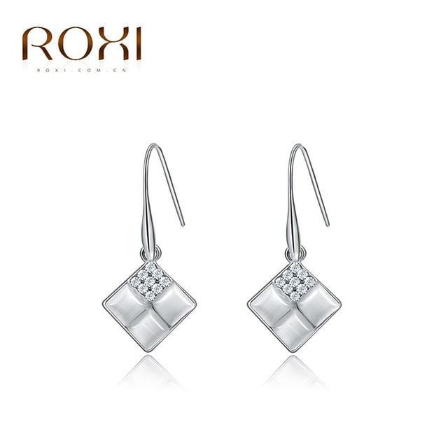 Roxi vacaciones de lujo cuelga los pendientes, blanco oro Color cristales Austríacos 100% Joyería hecha a mano de Cuatro Ángulos