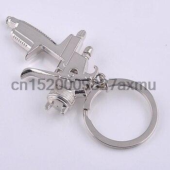 100PCS New Hot Water Spray Gun Quality Business Zinc Alloy Keychain Fashion Handbags Accessories
