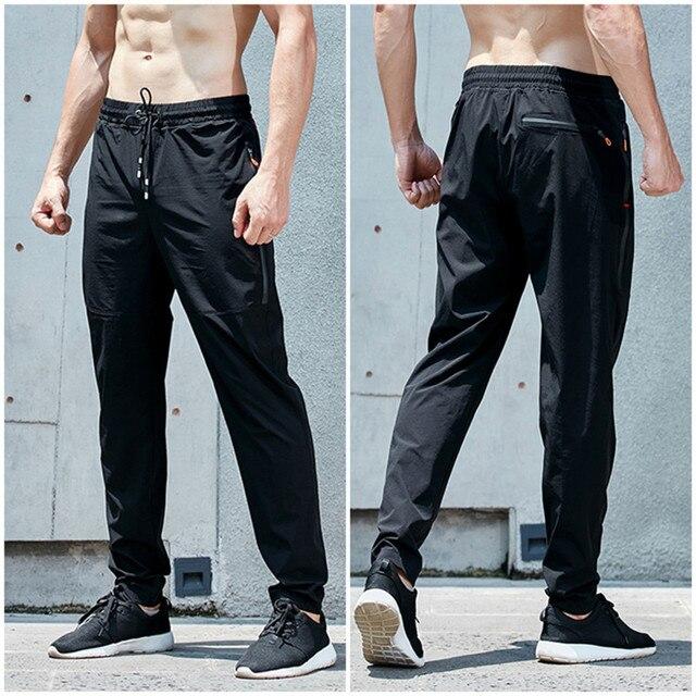 Nueva calidad superior Correr pantalón entrenamiento Fútbol jogging activo Pantalones  deportes Leggings gimnasio ropa hombres Pantalones ed02414e0cf31