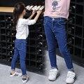 2017 весна и осень горячие моды классические детские эластичные джинсы 6-11 лет девушка сплошной цвет молния дикий мальчик штаны