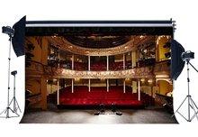 פנים תיאטרון הצג תפאורות לוקסוס שלב רקע Bokeh הניצוץ אורות אדום כיסא להקת קונצרט צילום רקע