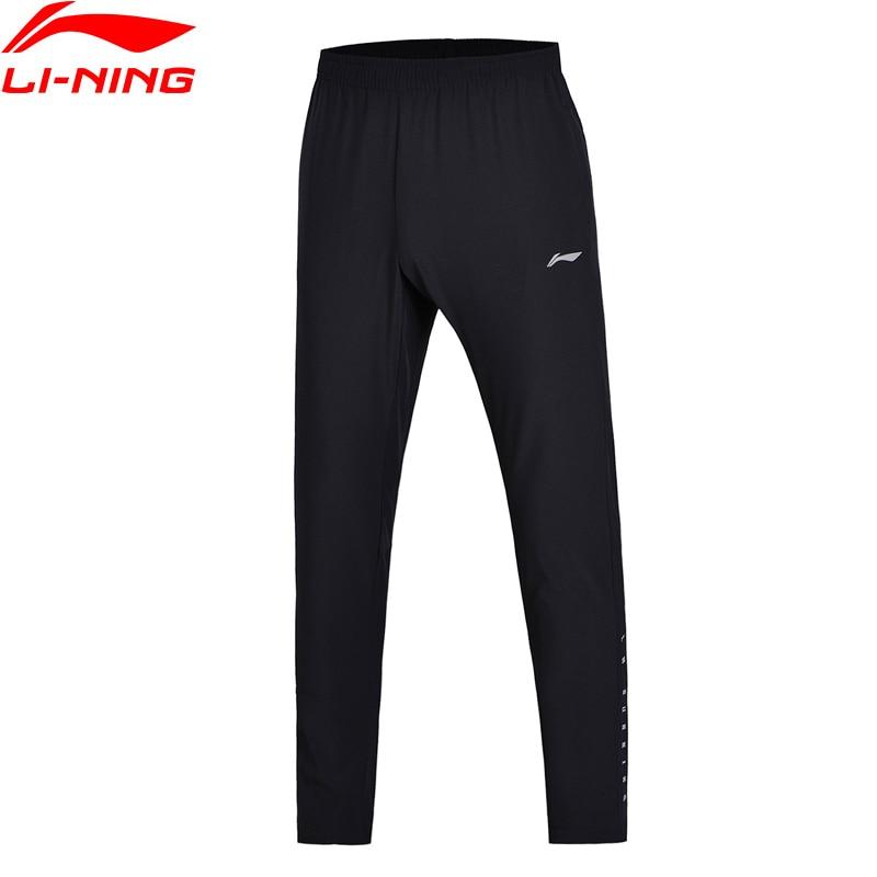 Li-Ning Men Running Jogger Track Pants Slim Fit Stretchy Fabric Comfort Woven Sports Pants AYKN011 drawstring stripe printed beam feet jogger pants
