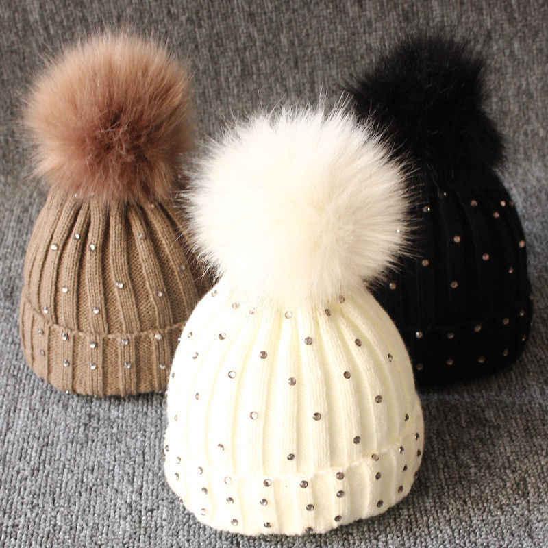 ทารกแรกเกิดเด็กทารกหญิงน่ารักที่ถัก Pompon Beanies หมวกฤดูหนาวอบอุ่นขน Pom เลื่อมหมวกถักหมวกขนแกะถักหมวก