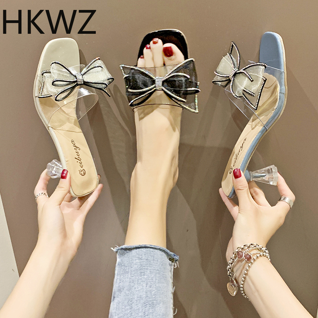 2019 summer brand new ladies slippers sweet rhinestone bow word drag Korean version of sexy transparent high heel wear sandals