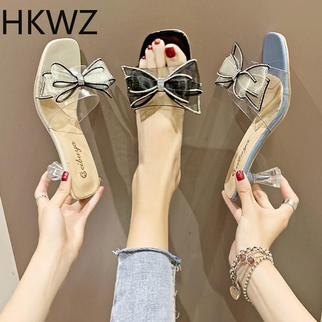2019 summer brand new ladies slippers sweet rhinestone bow word drag Korean version of sexy transparent high heel wear sandals
