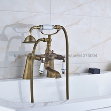 цена на Deck Mounted Antique Brass Clawfoot Bathtub Faucet telephone style Bath Shower Water Mixer tap with Handshower Nan013