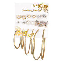 The New Korean Version Of Earpiece Exaggerated Artificial Pearl Grinding Large Circle Character Ear Nail 6 Pairs Suit