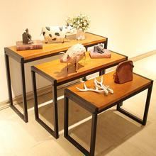 La etapa alta y baja de la tienda de ropa. Zapatero de mesa de exhibición de madera real vintage 1112