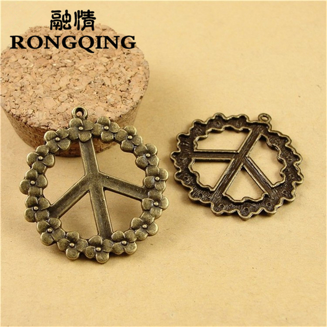 Rongqing trendy antique bronze 38mm flower pattern peace sign rongqing trendy antique bronze 38mm flower pattern peace sign pendants charms 40pcslot unique jewelry audiocablefo