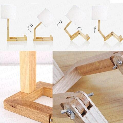 forma do robo lampada de mesa
