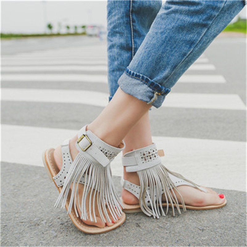 Flat sandals women 2017 summer luxury Black Casual Bohemia elegant sexy Beach Tassel decorated Shoes Open