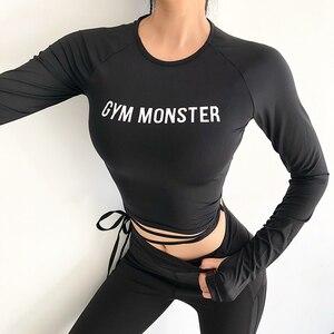 Image 2 - 女性のセクシーな長袖クロップトップ tシャツ迷彩ヨガシャツジムトップセクシーなスポーツ tシャツを実行している服