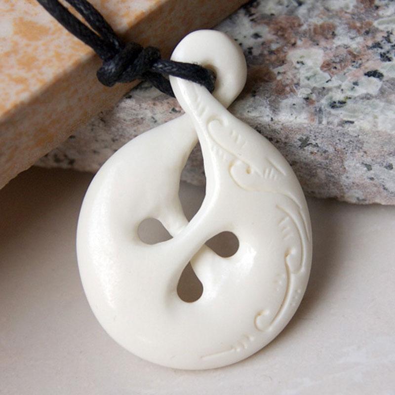 New zealand maori handmade carved ox bone cutout pendant