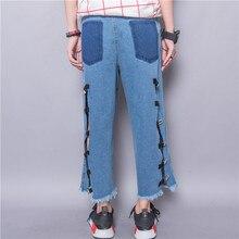 Мода улица персонализированные промывочной воды цвет блока карман за засов вырез вспышка расклешенных джинсов