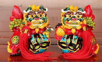 Jichenxuan Taiwán Cochin de cerámica León muerde espada péndulo un par de León artesanías para decoración del hogar para regalo