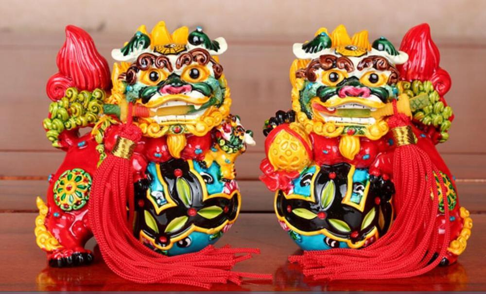 Jichenxuan Taiwan Cochin poterie colorée lion morsure épée pendule une paire de lion décoration de la maison artisanat cadeau