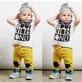 2016 Nuevo estilo del verano del bebé niños niñas ropa de la camiseta + pantalones de traje de algodón niños que arropan Los Niños bebe siguiente infantil ropa