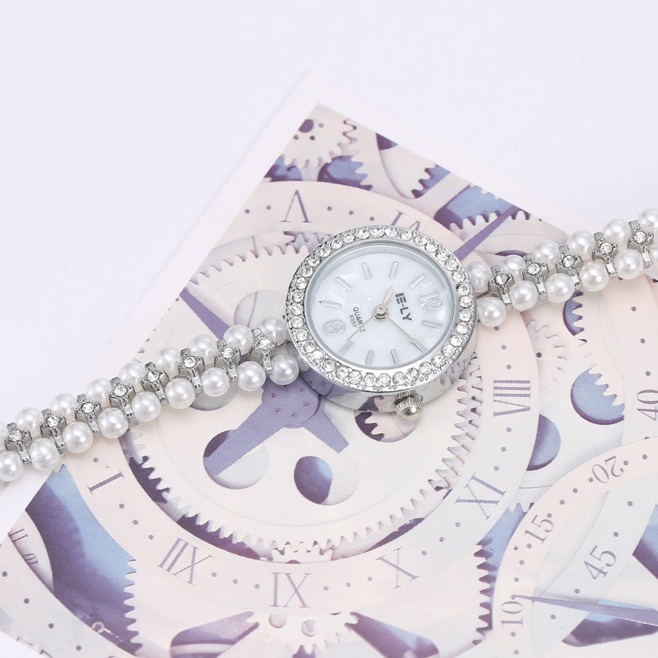 NanBo Quartz Watch Women Gold Pearl Jewelry Steel Bracelet Wristwatch Women Female Ladies Crystal Casual Fashion Watch Islamabad