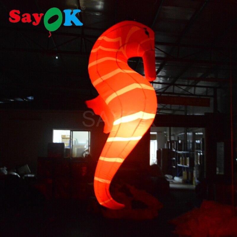 Décorations gonflables légères de cheval de mer de jouet de cheval de mer pour la maison accrochant le couturier 2.2 m rougeoyant avec 16 couleurs