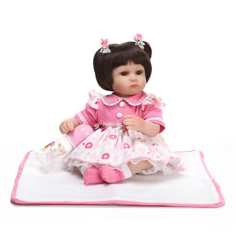 NPKCOLLECTION brand 1840cm silicone reborn baby girl dolls toys lovely dress brown hair fake baby doll bebe doll bonecasNPKCOLLECTION brand 1840cm silicone reborn baby girl dolls toys lovely dress brown hair fake baby doll bebe doll bonecas