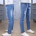 2017 весной новорожденных девочек мода тощий жан для детей высокие упругие проблемные горячий бурения дети джинсовые брюки карандаш FC124